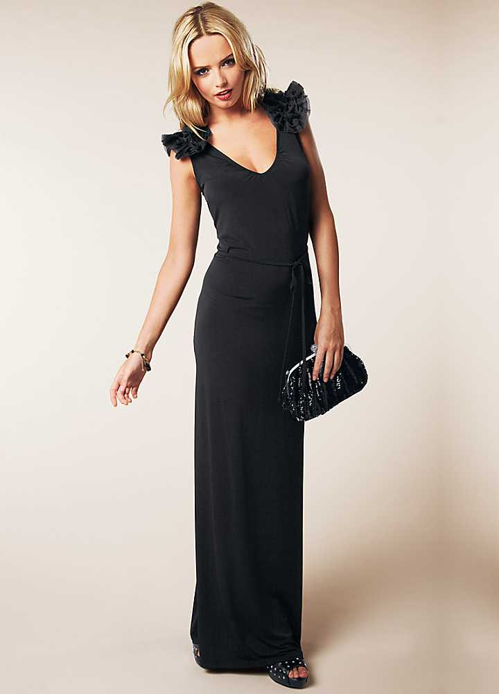 5fe4d679fc This is a classic black evening dress guaranteed to make you feel like the  belle of the ball. What s your favourite geek to chic makeover movie
